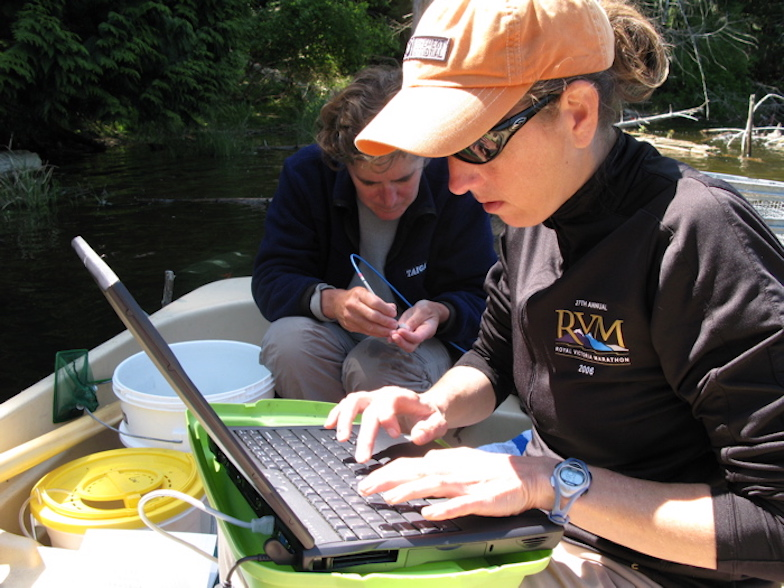 May 2007: Katie Peichel and Jenny Boughman collect male colour data on Enos Lake, British Columbia, Canada.